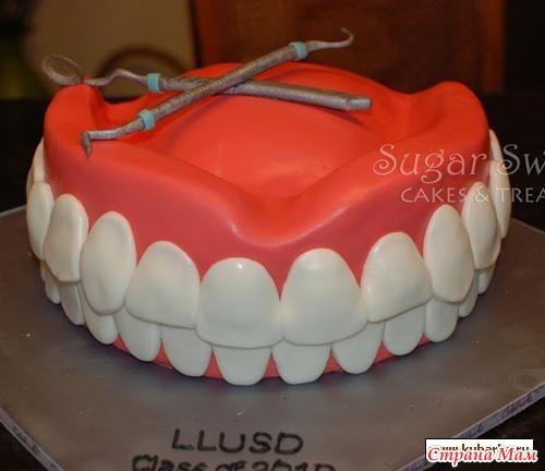 Торт из мастики в виде зуба фото