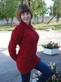 Бордовый джемпер с косами