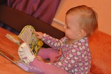 Софье пока только годик и читать она не умеет, но зато очень любит рассматривать книжки. Мы очень хотим получить электронную книгу PocketBook  т.к. она пригодится нам в дальнейшем для обучения Софьи, ведь в наше время без эл.книги просто ни куда!