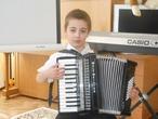 Максим на концерте в музыкальной школе