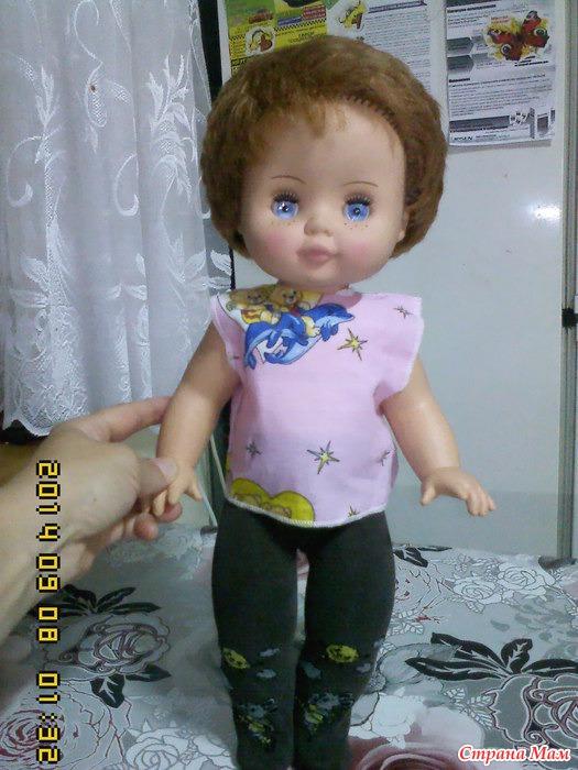 вот эту куклу из садика одеваем к зиме