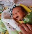 Первая осознанная  улыбка малыша